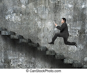 Man using tablet running on old dirty concrete stairs with...