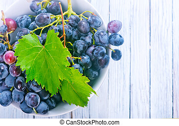 grape in bowl and on a table