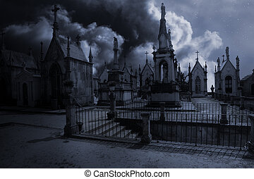 Spooky moonlit old european cemetery in a cloudy night with...