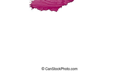purple paint pouring on white in slow motion. Colored paint...