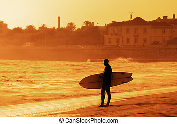 Surfer Silhouette - Silhouette of a surfer with his...