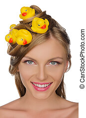 beautiful woman with yellow ducks in her hair isolated on...