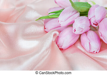 Flowers on a silk fabric - Bouquet of tulip flowers on a...