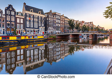 Amsterdam canal Singel with dutch houses, Holland -...
