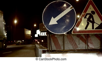 Repairs signs - Repairs on the highway in the night, symbol...