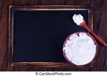 Soda - baking soda in bowl and on a table