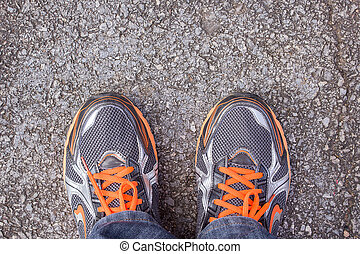 Top view of men's running shoes on a street