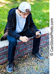 Teenager with Tablet Comuter