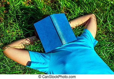 Teenager sleep with the Book - Person take a rest on the...