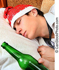 Teenager sleep with a Beer - Young Man sleep in Santa Hat...