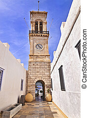 Dormition church Hydra Greece - clock tower in front of the...