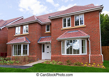 New detached brick built house - Photo of a brand new...