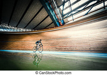 Sprinting - Racing cyclist on a cycle track