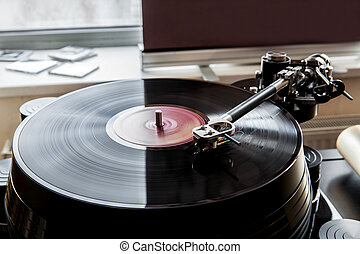 Retro Vinyl player - Close up of a record player playing...