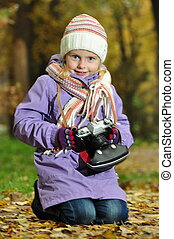 child with a camera in nature