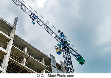Crane with building construction site