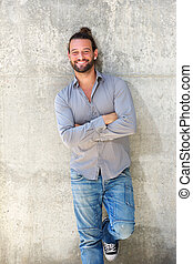 Handsome man smiling with arms crossed - Portrait of...