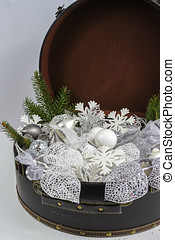 Vintage brouwn coffer with white christmas tree decoration...