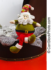 Santa Claus sits on vintage brouwn coffer with white...