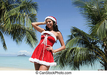 Mrs Claus on tropical beach - Beautiful woman in Mrs Claus...