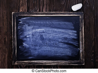 black board and chalk on a table