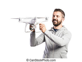 Man holding drone. Studio shot on white background, isolated...