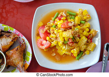 Som Tum papaya salad with corn - spicy Thai food - Famous...