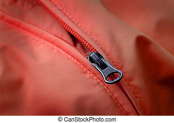 Zipper on Red Coat with Texture - Closeup of zipper on Red...
