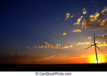 Windmill at Sunset Generating Sustainable Power - Windmill...