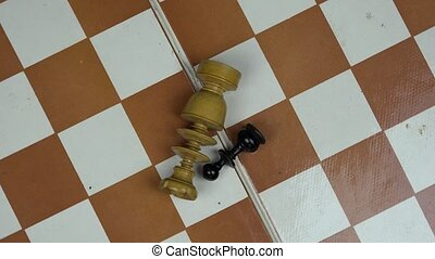 wooden chess figures lying on chess board. turntable -...