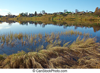 Fall River, reflected in the water autumn trees. Arkhangelsk...