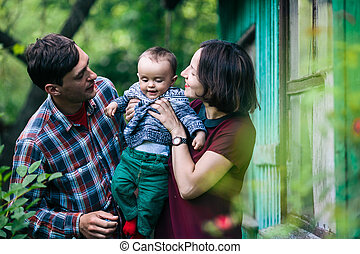 young family with a child on the nature - Young family with...