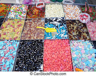 Colorful Candy Stand - Colorful stand in outdoor market with...
