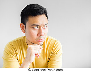 Asian man is thinking.