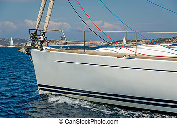 Sailing yacht under the engine, bow close view. - Sailing...
