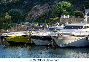 Close view on luxury motor boats at Poltu Quatu. - Close...