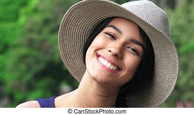 Smiliing Pretty Teen Female Wearing Hat
