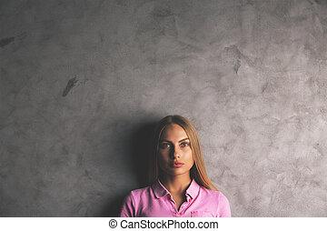 Pretty woman on concrete background - Portrait of pretty...