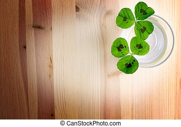 Clover Wood Background - Three leaf clover on a wood...