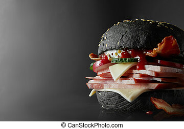 Black Burger with Cheese. - Cheeseburger from Japan with...
