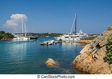 Yacht marina at Porto Cervo bay. Scenic views of Sardinia...