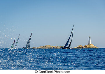 Sailing super yacht with black sails is racing in the Med -...