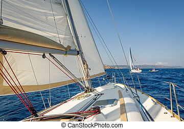 Sailing boat going fast on she's sails, view from the...