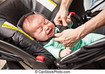 Crying baby being strapped to a stroller - Very upset...