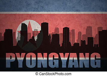 abstract silhouette of the city with text Pyongyang at the...