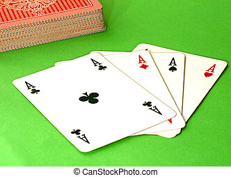 Four Aces - Four aces on the table, green background