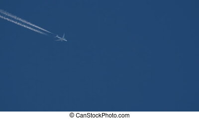 Widebody airliner flying high - Contrails in the blue sky....