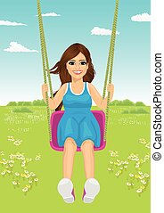 young woman riding a swing in park in summer