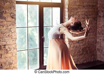 Beautiful graceful woman standing in the sunbeams - Feel the...