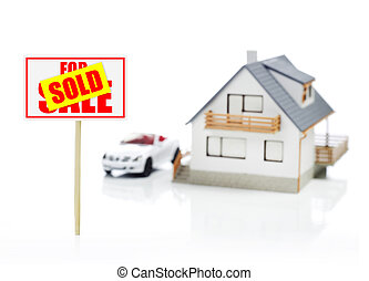 Sold sign and model house